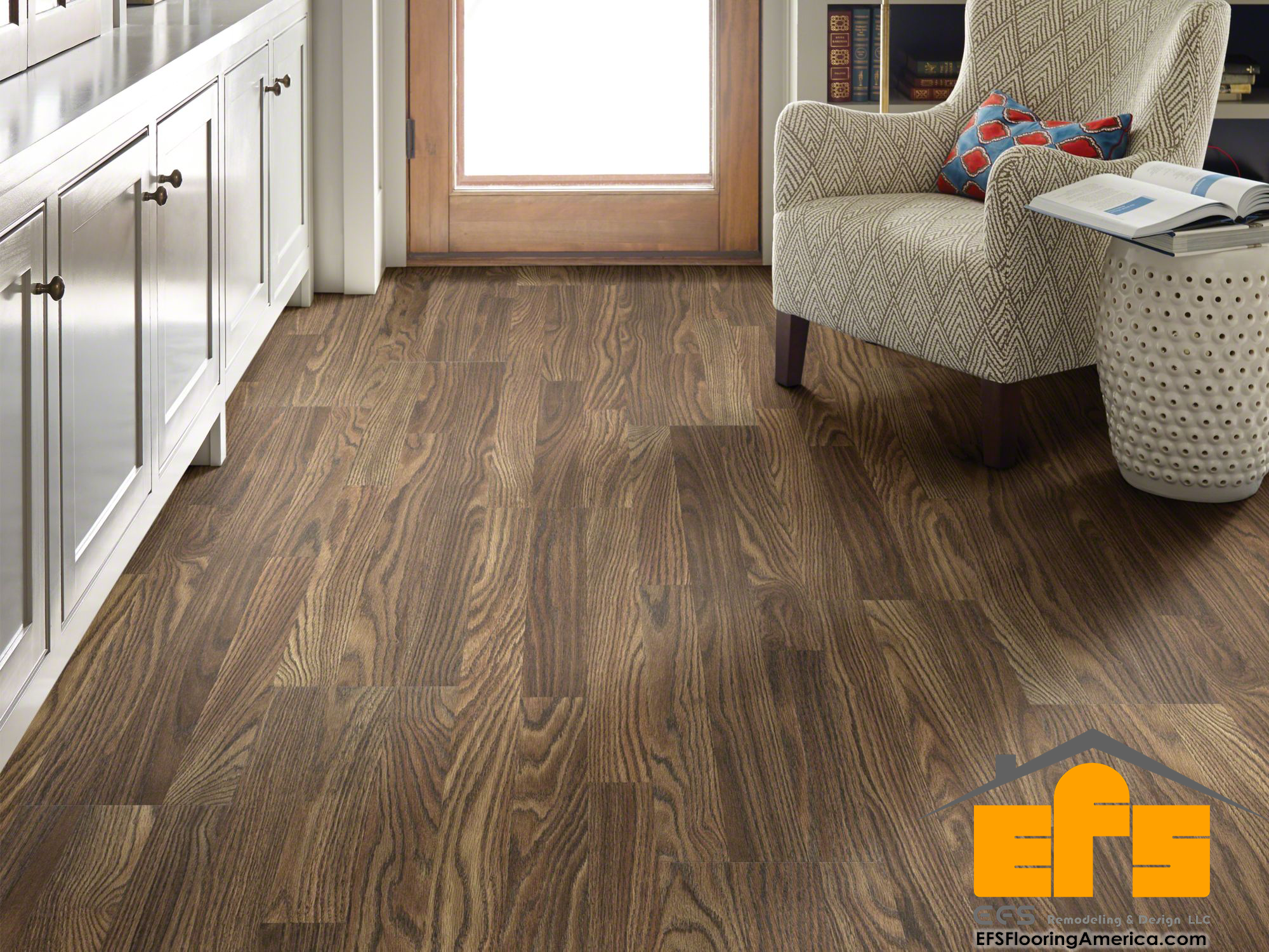 What is the difference between laminate and PVC flooring?